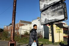 A child walks down a street on Oct. 11, 2012, in Camden, N.J., the most impoverished city in the United States, with nearly 32,000 of Camden's residents living below the poverty line.